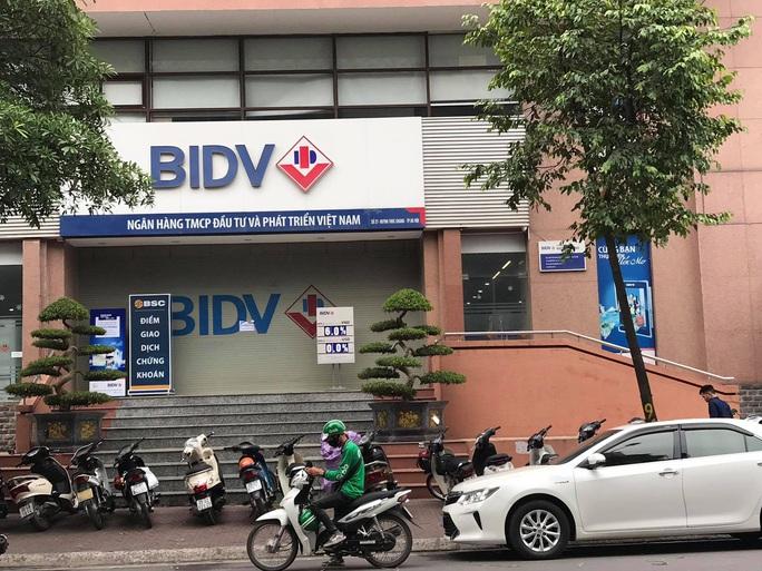 Khởi tố vụ nổ súng cướp Ngân hàng BIDV tại Hà Nội - Ảnh 1.