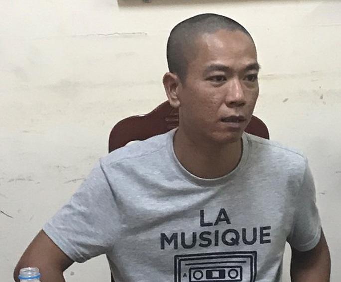 Bắt 2 nghi phạm bịt mặt nổ súng cướp Ngân hàng BIDV tại Hà Nội - Ảnh 1.