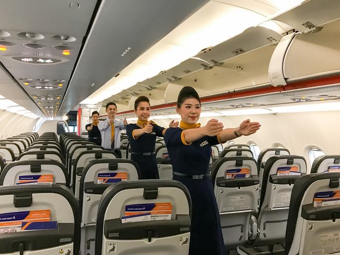 Pacific Airlines chính thức ra mắt đồng phục tiếp viên và bộ nhận diện thương hiệu mới - Ảnh 5.