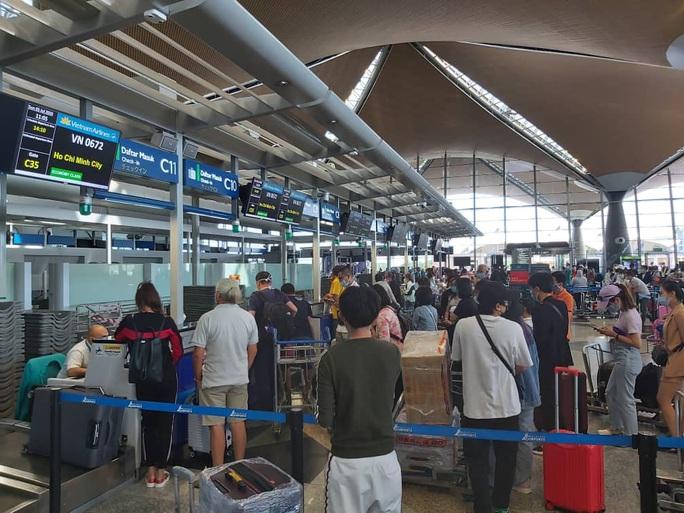 Sân bay Cần Thơ đón 310 người Việt tại Malaysia về nước - Ảnh 4.