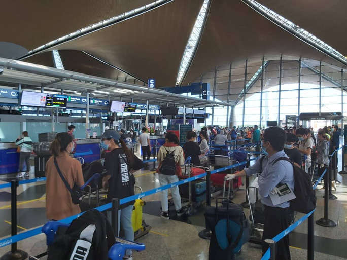 Sân bay Cần Thơ đón 310 người Việt tại Malaysia về nước - Ảnh 5.