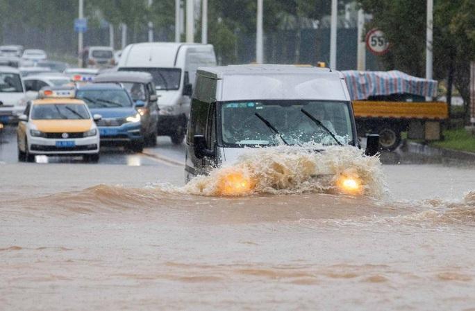 Sông Trung Quốc vượt mức cảnh báo, Nhật chạy đua với thời gian - Ảnh 4.