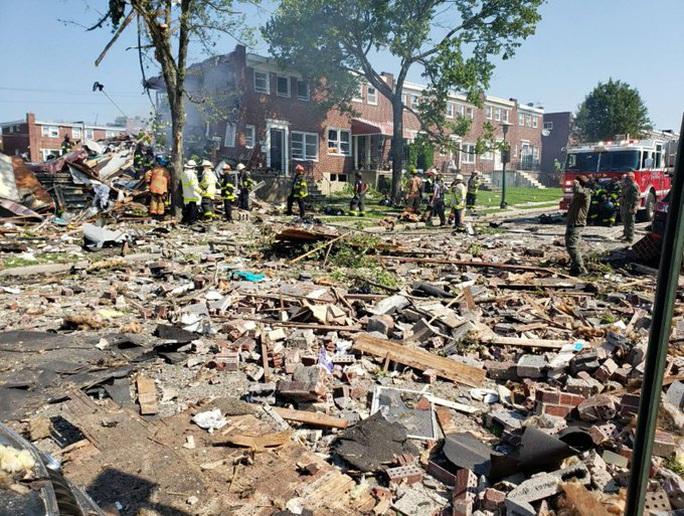 Mỹ: Sau tiếng nổ kinh hoàng, 3 ngôi nhà liền kề sụp đổ - Ảnh 4.