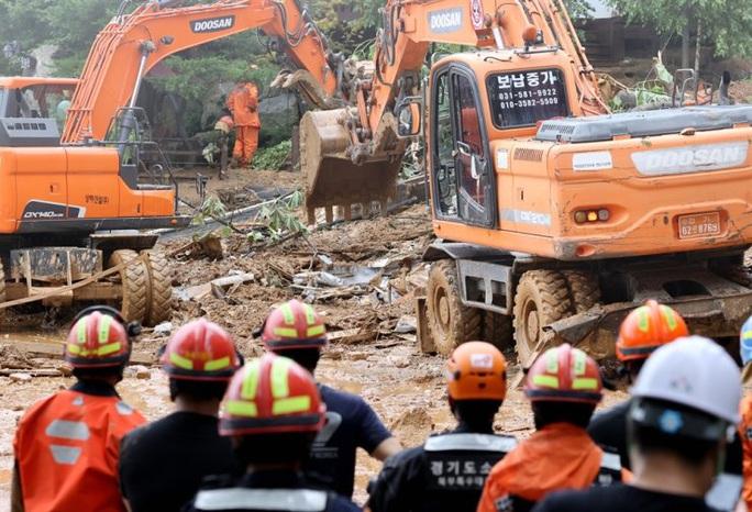 Mưa bão hoành hành tại Trung Quốc, Hàn Quốc, Mỹ - Ảnh 1.