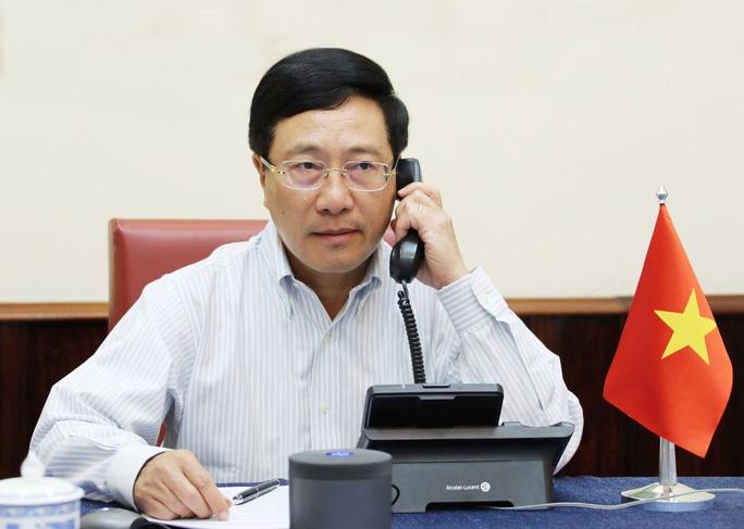 Phó Thủ tướng, Bộ trưởng Ngoại giao Phạm Bình Minh Điện đàm với Ngoại trưởng Mỹ - Ảnh 2.