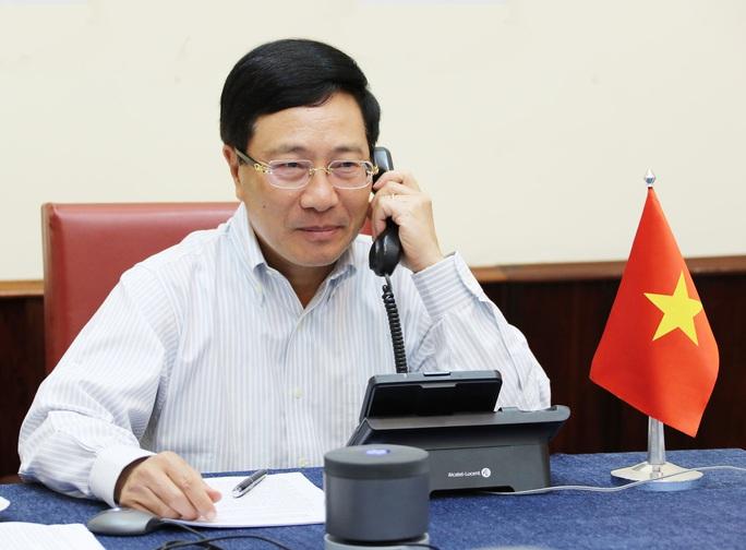 Phó Thủ tướng, Bộ trưởng Ngoại giao Phạm Bình Minh Điện đàm với Ngoại trưởng Mỹ - Ảnh 1.