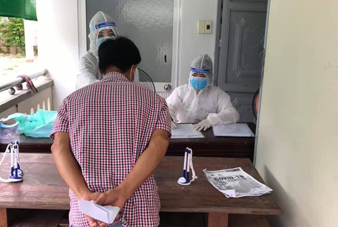 Nữ nhân viên y tế ở Quảng Nam cam kết cách ly nhưng vẫn đi làm - Ảnh 1.