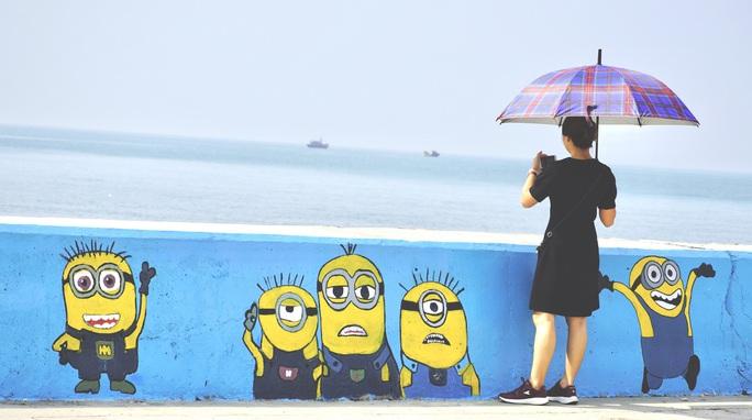 Đẹp ngỡ ngàng trước hàng trăm bức hoạ biến làng chài Phước Hải thay áo mới - Ảnh 12.