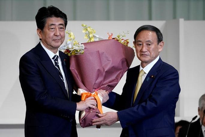 Tiến sát ghế thủ tướng Nhật Bản, ông Suga tuyên bố không nhượng bộ Trung Quốc - Ảnh 1.