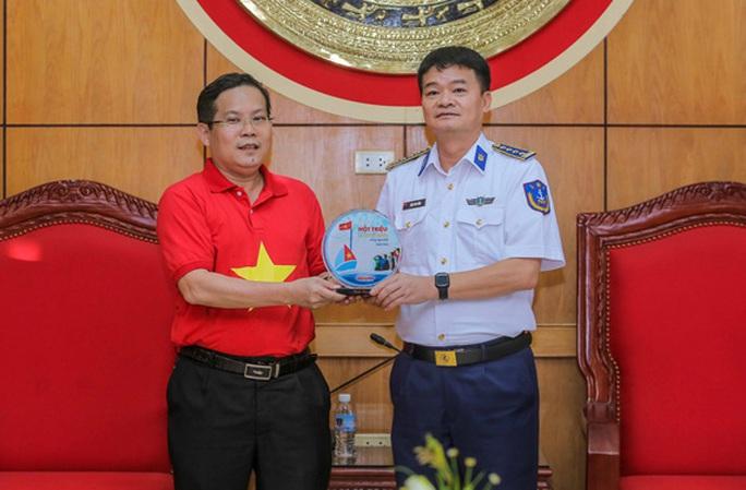 Báo Người Lao Động tăng cường hợp tác với Bộ Tư lệnh Vùng Cảnh sát biển 1 - Ảnh 1.