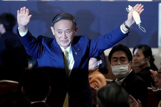 Ông Yoshihide Suga lãnh đạo đảng cầm quyền, cầm chắc ghế thủ tướng Nhật Bản - Ảnh 1.