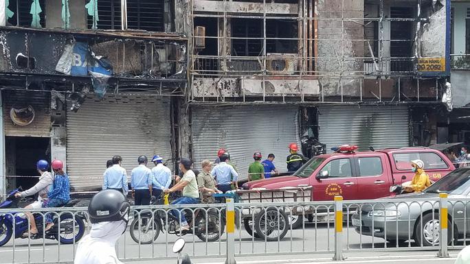 Triệu tập người đàn ông, điều tra nghi án đốt phòng giao dịch Eximbank ở Gò Vấp - Ảnh 1.