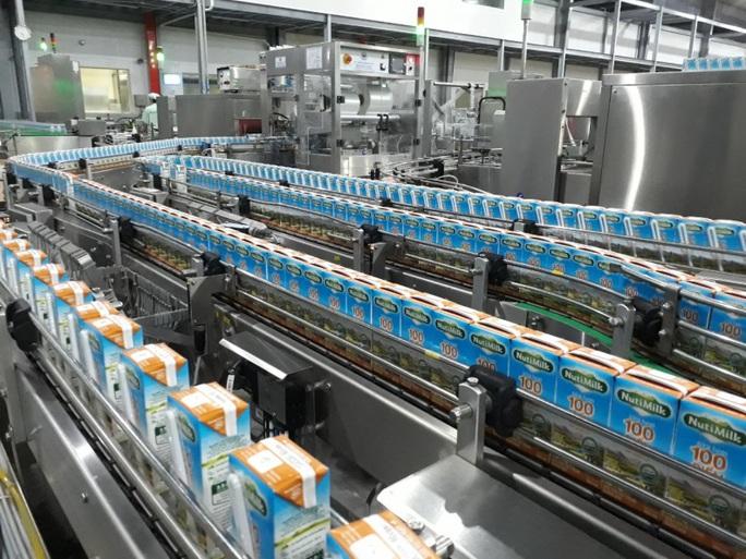 Sữa tươi chất lượng cao 100 điểm Nutimilk - Dấu ấn mới của Nutifood - Ảnh 4.