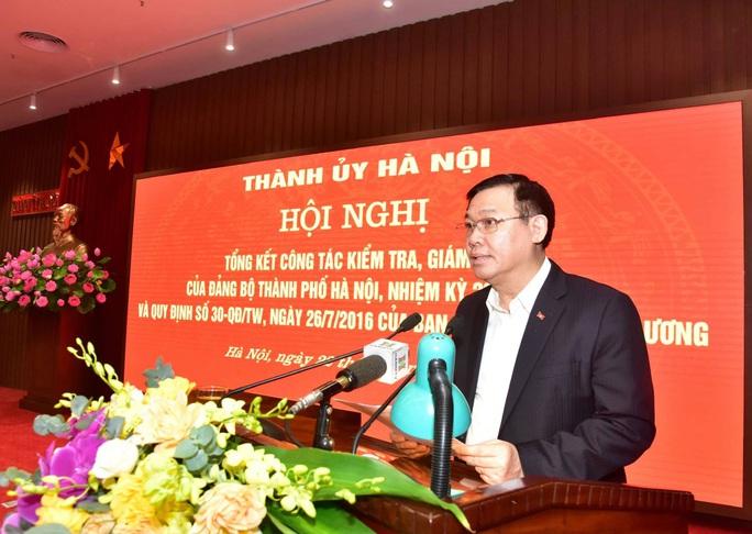 Kỷ luật nhiều cán bộ diện Ban Thường vụ Thành ủy Hà Nội quản lý - Ảnh 1.