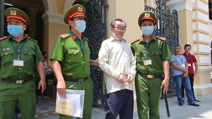 Đối tượng tổ chức vụ đặt chất nổ tại trụ sở Công an phường 12, quận Tân Bình lãnh 24 năm tù - Ảnh 1.