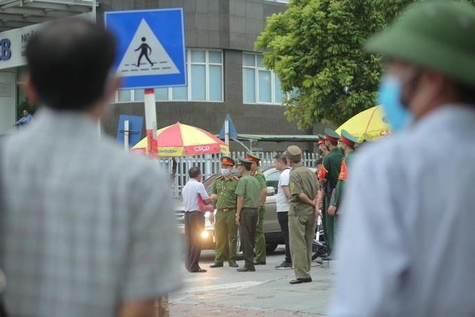 Sáng nay 7-9, thắt chặt công tác an ninh cho phiên tòa xét xử 29 bị cáo ở Đồng Tâm - Ảnh 20.