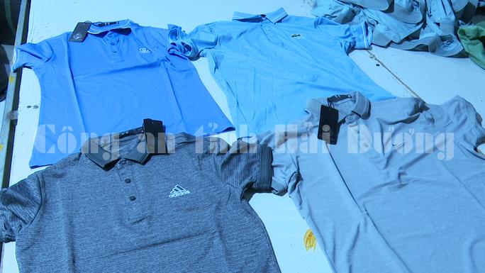 Đột kích xưởng sản xuất, gia công cả ngàn áo thể thao giả Adidas, Nike, Lacoste - Ảnh 3.