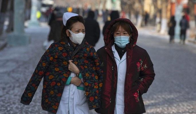 Dấu hiệu đáng lo ngại của dịch Covid-19 ở Trung Quốc - Ảnh 2.