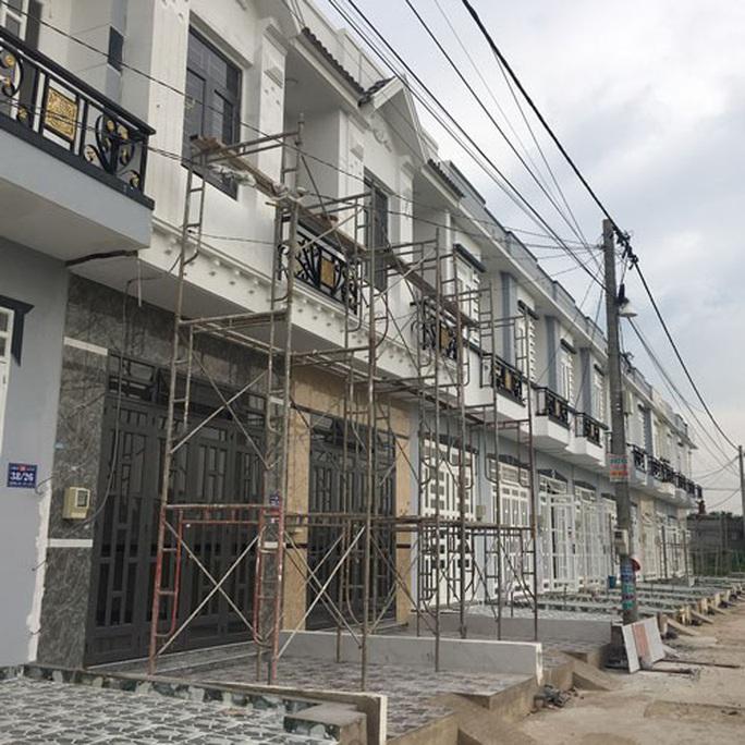 Khó xử lý vi phạm nhà 3 chung, UBND TP HCM xin ý kiến Bộ Xây dựng - Ảnh 1.