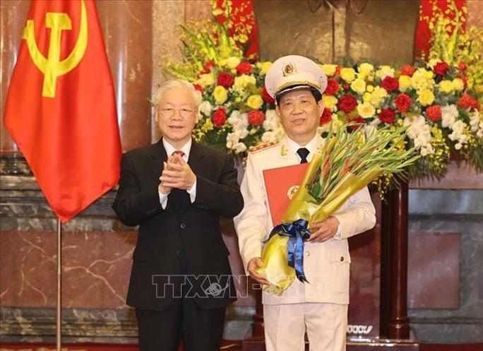 Tổng Bí thư, Chủ tịch nước trao Quyết định thăng cấp bậc hàm Thượng tướng cho Thứ trưởng Bộ Công an - Ảnh 1.