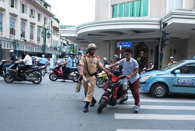 Quy định mới: Xe máy điện bắt buộc phải mua bảo hiểm từ ngày 1-3 - Ảnh 1.