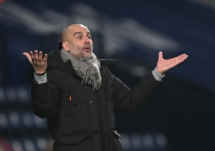 HLV Guardiola nói gì khi Man City chiếm ngôi đầu bảng của Man United? - Ảnh 3.