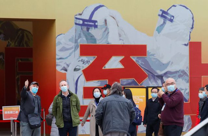 Nhóm chuyên gia WHO bắt đầu vén màn sự thật tại Vũ Hán - Ảnh 2.