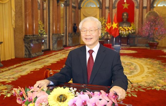 Tổng Bí thư, Chủ tịch nước: Phát huy sức mạnh và ý chí vươn lên của dân tộc - Ảnh 1.