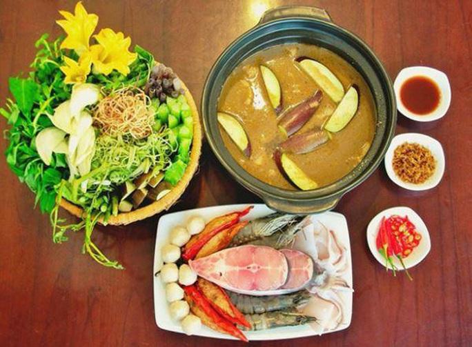 Thưởng thức 4 đặc sản ở Cà Mau lọt tốp món ăn, quà tặng ngon nhất Việt Nam - Ảnh 13.