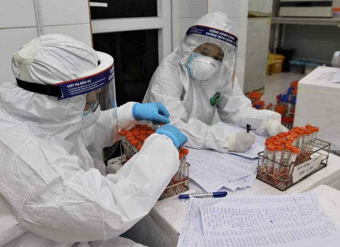 Công nhân có xét nghiệm âm tính với SARS-CoV-2 được về quê ăn Tết - Ảnh 1.