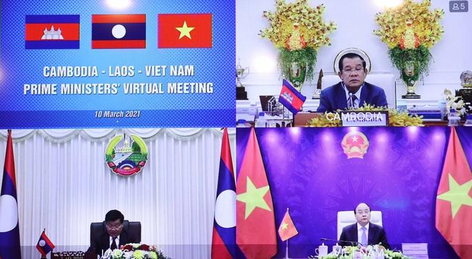 Việt Nam, Lào, Campuchia nhất trí tiếp tục tạo điều kiện thông quan thuận lợi qua các cửa khẩu - Ảnh 1.