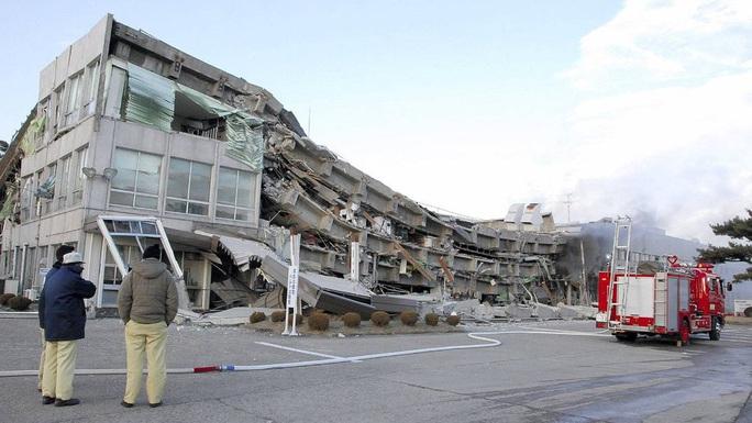 Nhìn lại thảm họa động đất - sóng thần làm nghiêng trục Trái Đất 10 năm trước - Ảnh 1.