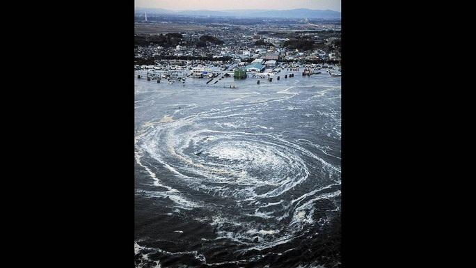 Nhìn lại thảm họa động đất - sóng thần làm nghiêng trục Trái Đất 10 năm trước - Ảnh 10.