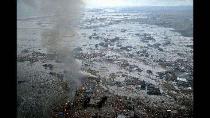 Nhìn lại thảm họa động đất - sóng thần làm nghiêng trục Trái Đất 10 năm trước - Ảnh 14.