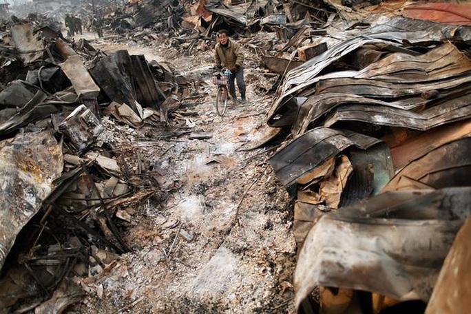 Nhìn lại thảm họa động đất - sóng thần làm nghiêng trục Trái Đất 10 năm trước - Ảnh 18.