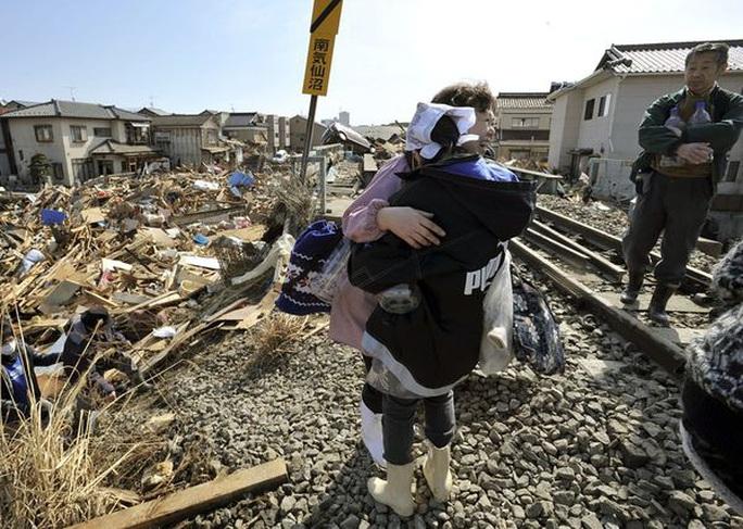 Nhìn lại thảm họa động đất - sóng thần làm nghiêng trục Trái Đất 10 năm trước - Ảnh 20.