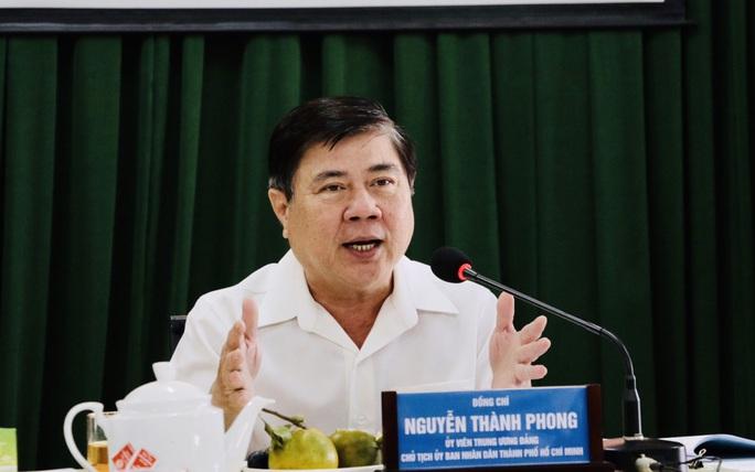 Chủ tịch UBND TP HCM cảnh báo giá đất bị đẩy do thông tin chuyển 5 huyện thành quận - Ảnh 1.