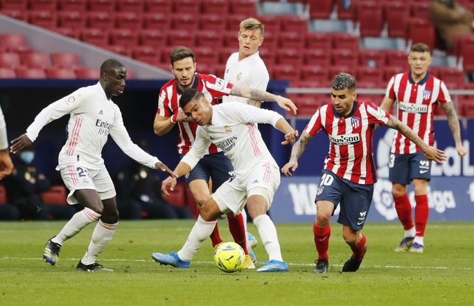 Benzema cứu Real Madrid, Atletico nợ chồng chất trận derby thủ đô - Ảnh 7.