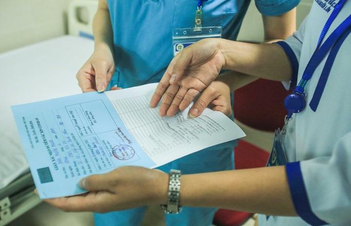 CLIP: 30 nhân viên y tế đầu tiên tại Bệnh viện Thanh Nhàn được tiêm vắc-xin Covid-19 - Ảnh 16.