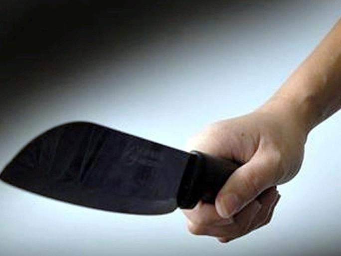 Thanh niên dùng rựa chém cụ bà để tẩu thoát khi bị bắt quả tang trộm đồ - Ảnh 1.