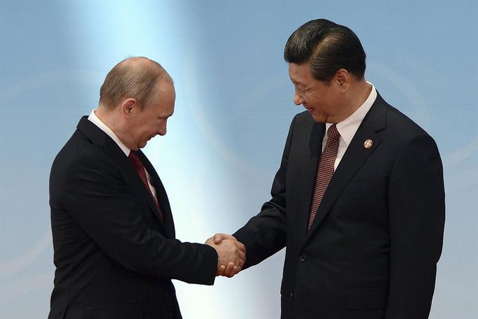 Trung Quốc, Nga, Triều Tiên và Iran bắt tay nhau chống Mỹ - Ảnh 1.