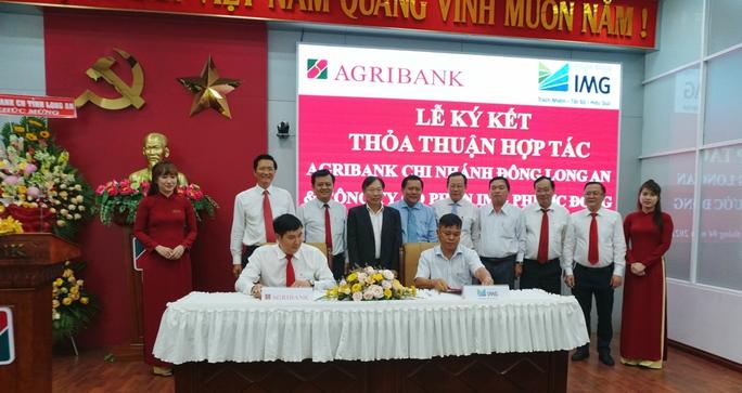 Agribank đóng góp tích cực cho sự phát triển của Long An - Ảnh 1.