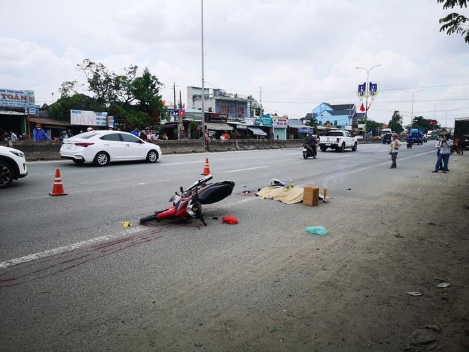 Cán chết người, tài xe container chạy khoảng 1km mới biết - Ảnh 1.