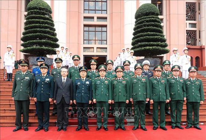 Bộ trưởng Phan Văn Giang đón Bộ trưởng Quốc phòng Trung Quốc thăm Việt Nam - Ảnh 7.