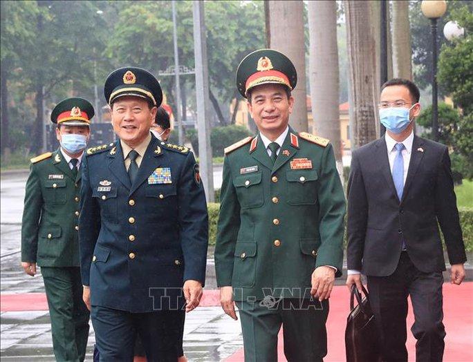 Bộ trưởng Phan Văn Giang đón Bộ trưởng Quốc phòng Trung Quốc thăm Việt Nam - Ảnh 3.
