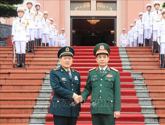 Bộ trưởng Phan Văn Giang đón Bộ trưởng Quốc phòng Trung Quốc thăm Việt Nam - Ảnh 6.