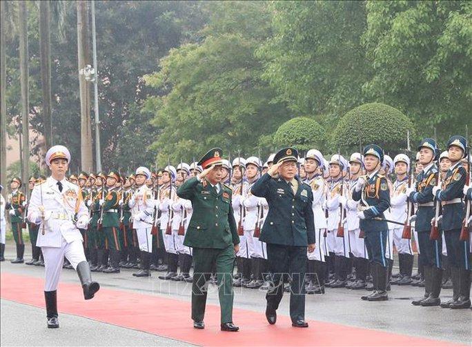 Bộ trưởng Phan Văn Giang đón Bộ trưởng Quốc phòng Trung Quốc thăm Việt Nam - Ảnh 4.