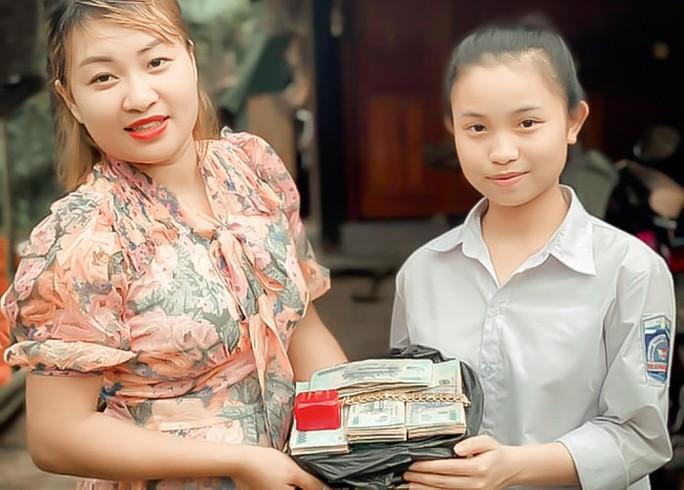 Nhặt được gần nửa tỉ đồng, nữ sinh lớp 10 trả cho người đánh rơi - Ảnh 1.