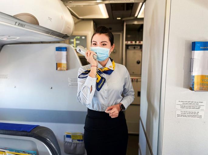 Hướng dẫn viên trên tàu bay - Trải nghiệm tiên phong mới của Vietravel Airlines - Ảnh 2.