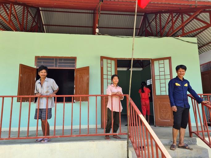 Người dân vùng sạt lở Trà Leng hân hoan về nhà mới - Ảnh 6.